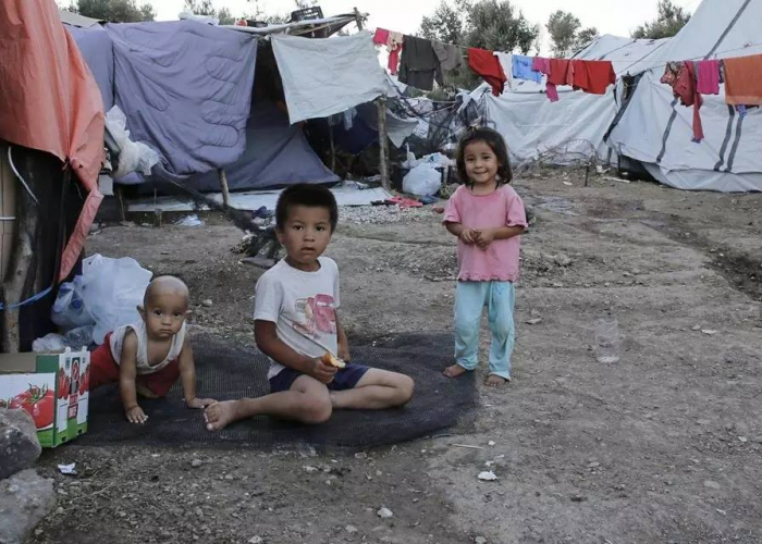 Image with news article: Refugees struggle to survive on Samos